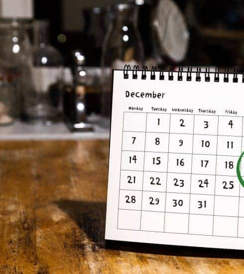 Calendar with dates circled for a weekend in December